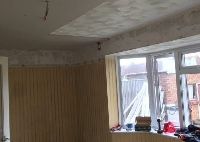 Plasterboarding the ceiling.